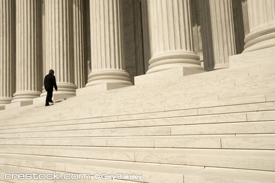 A man ascending the steps at the entrance to t...