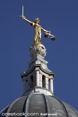 statue of justice, a woman holding a sword in ...